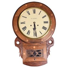 A Victorian walnut wall clock
