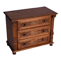 A Victorian oak miniature chest of drawers