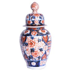 A nineteenth century Imari ginger jar and cover.