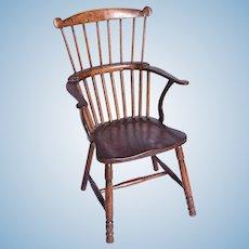 A Victorian miniature oak Windsor armchair