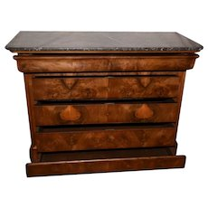 A Louis-Philippe figured walnut commode