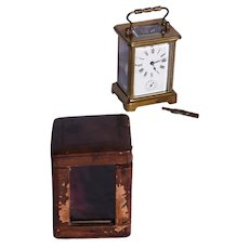 A nineteenth Century brass alarm carriage clock with case