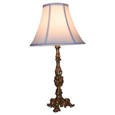 A Victorian rococo brass lamp