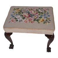 A twentieth Century mahogany foot stool