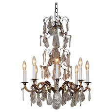 A Louis XVI style eight branch crystal chandelier