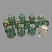 13 Hemingray Green Glass Insulators (all with minor to significant damage)