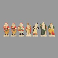 Set of Seven Vintage Ceramic Santa Clause Through the Years Figurines/ Ornaments