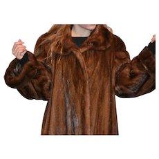 Full length Saga Mink coat in brown color