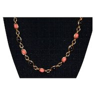 Vintage gold tone necklace with black and coral beads