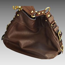 COACH authentic leather handbag in brown color