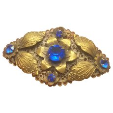 Vintage Art Deco Brass Filigree Pin With Electric Blue Stones