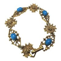 Vintage Florenza Embossed Panel Bracelet With Blue Glass Cabochons