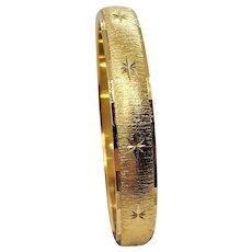 Vintage Monet Bangle Bracelet With Brushed Gold Tone Star Finish