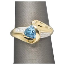 1.00ct Blue Topaz and Diamond 14k Yellow Gold Bypass Ring Size 7