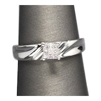 0.20ctw Diamond and White Gold Engagement Ring