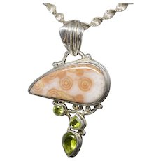 Handcrafted Fossilized Coral and Peridot Pendant In Sterling Silver