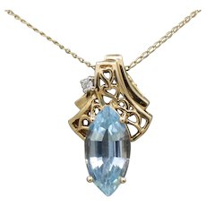 Vintage Blue Topaz Marquise Cut and Diamond Pendant Necklace in 14k Yellow Gold