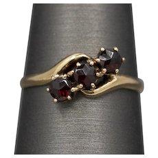 Edwardian Rose Cut Garnet Three Stone Ring in 10k Yellow Gold