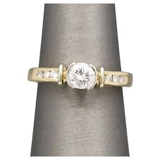 Modern Semi-Bezel Set Diamond Engagement Ring with Channel Set Diamonds in 14k Yellow Gold
