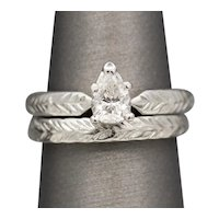 Pear Cut Diamond Engagement Ring and Wedding Band Set in Engraved Platinum