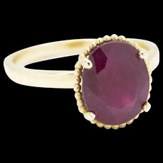 3.60ct Oval Cut Ruby Solitaire Ring with Bead Detail in 14k Yellow Gold