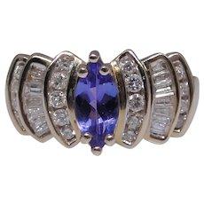 Tanzanite and Diamond ring, 14kt gold, size:  7