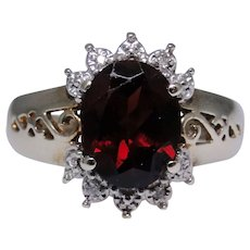 10kt gold Garnet ring with small diamonds size: 8.25