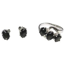 Vintage 18kt white gold and black star Sapphire ring and earring set, excellent estate condition