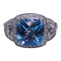 Ornate 14kt white gold estate ring with Blue Topaz and diamonds