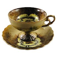 Ornate yellow Peony cup and saucer set, numbered