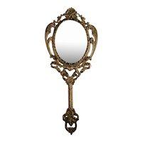 Vintage ornate brass vanity mirror