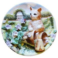 Unique vintage decorator plate featuring cat in garden, relief, excellent vintage
