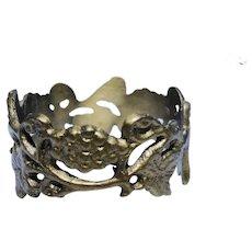 Ten vintage brass ornate napkin rings, grape vines