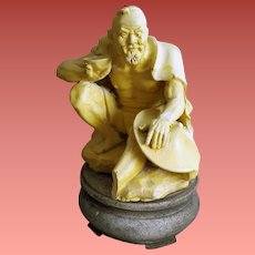 Carved Bakelite Asian Chinese Figure on Stand