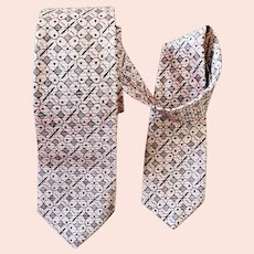 1960s Narrow Necktie Iconic Black and Pink Silk