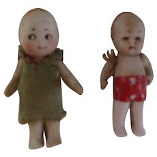 A Pair of German All Bisque 2 Inch Dolls