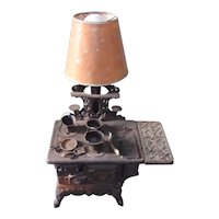 Vintage Crescent Cast Iron Toy Stove Lamp with Pots and Pans
