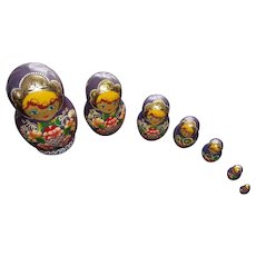 Sweet Set of Hand Painted Russian nesting Dolls( Artist signed and Dated 1999 )