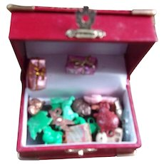 A Wonderful Miniature Vintage Red and Brass Trunk with Vintage Cracker Jack Toys