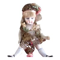 Antique All Bisque Doll with the Sweetest Face ( comes with a lovely presentation box )