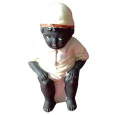 Black Americana Figurine, Black Boy Sitting on a Chamber Pot