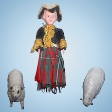 A Tiny Celluloid Doll and Miniature Metal Sheep