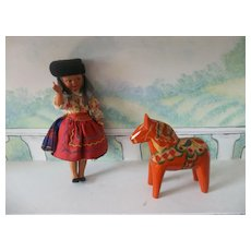 Vintage Painted Dala Horse with a Beautiful Doll