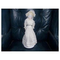 A Stunning Blonde China Doll with Beautiful Dress