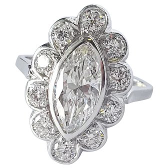 Marquise and Round cut Diamond Ring in PLAT