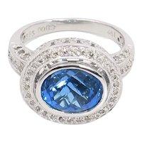14 Karat White Gold Blue Topaz and Diamond Ring