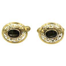 Black Star Sapphire Cufflinks   18 Karat Yellow Gold