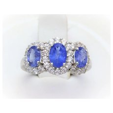 Three Stone Tanzanite and White Sapphire Halo Ring