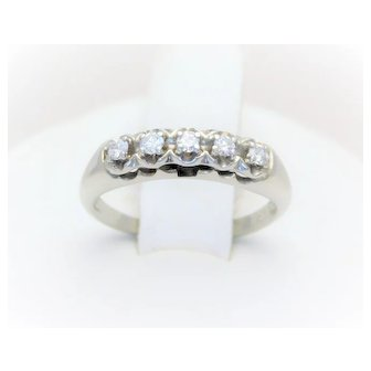 Vintage 14k White Gold 0.18ct Diamond Anniversary Band  From a lovely New Orleans estate.  Circa 1980.  This gorgeous wedding-style band has been crafted in solid 14k white gold.  It has been masterfully jeweled with a total of (4) round brilliant-cu