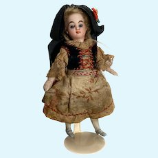 French All-Bisque Mignonette with fine traditional costume and painted blue shoes - 5 ¼ inches